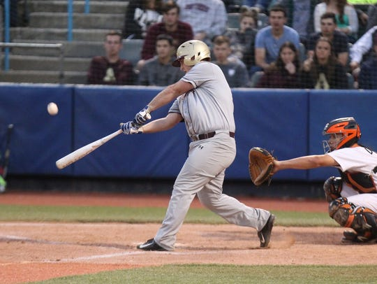 Arlington's Andrew Biasotti connects during the Section 1 Class AA final against White Plains at Dutchess Stadium in Fishkill on May 27, 2017.