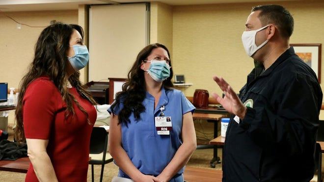 Orange County Executive Steven M. Neuhaus talks to ICU nurses Melanie Pinto and Sarah Stewart at Garnet Health Medical Center in Middletown.