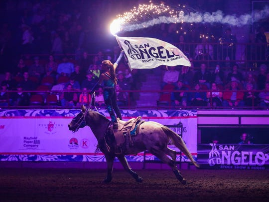 Emily Charlesworth rides in the arena with the rodeo flag for the 3rd performance of the San Angelo Stock Show and Rodeo Saturday, Feb. 3, 2018, at Foster Communications Coliseum.