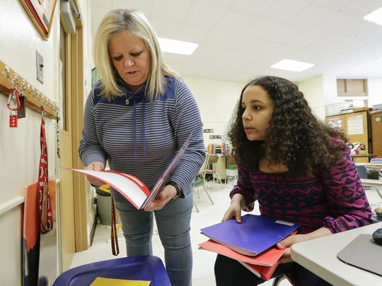 FILE - Isabella, then 16, right, works with her special education teacher Mary Smith at Wilson Junior High School on Feb. 9, 2018, in Manitowoc.