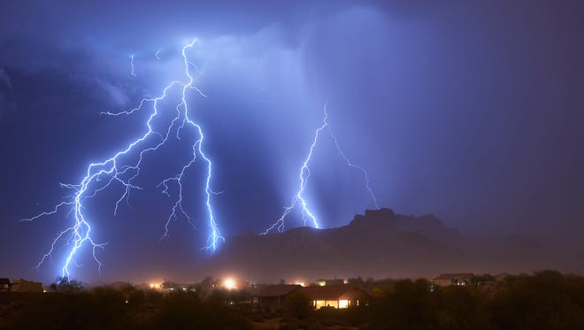 Lightning tonight in the East Valley, looking east to the Superstition Mountains.