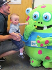 A father and his son enjoy meeting Story Monster at