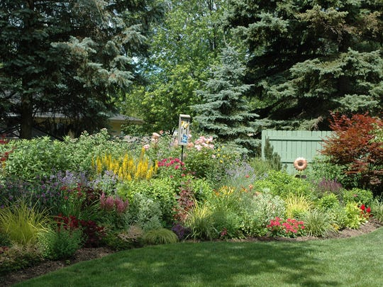 Topdress your border gardens in fall to yield a lush yard the following summer.