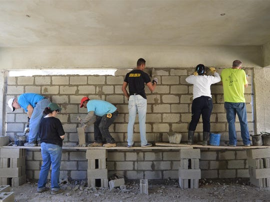 Volunteers put up a wall during a previous Lifetouch