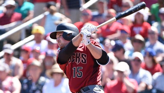 GOODYEAR, MARCH 20:  Phil Gosselin #15 of the Arizona Diamondbacks hits a two run home run during the first inning against the Cincinnati Reds at Goodyear Ballpark on March 20, 2016 in Goodyear, Arizona.