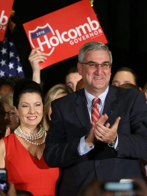 Eric Holcomb (R) celebrates his win in the Indiana Governor race with his supporters at the Indiana GOP election party Tuesday, November 8, 2016, at the at the JW Marriott.