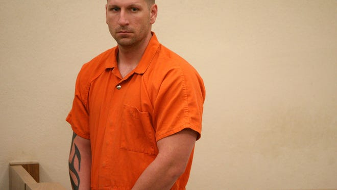 Ricky Delk, a Daytona Beach police officer accused of firing a weapon in his home while arguing with his wife during his first appearance at the Volusia County Branch Jail on November 12, 2010.