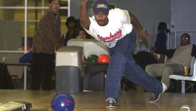 Fred Malcolm uses great form when bowling in 2000 at AMF Olympic Lanes.