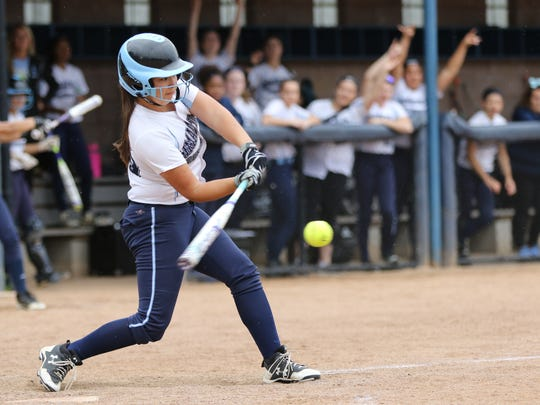 Kayla Robert connects in Immaculate Conception's five-run third inning.  Immaculate Conception went on to beat Wildwood Catholic in the State Non-Public B Softball Championship in Union, 8-2, Sunday June 4, 2017.