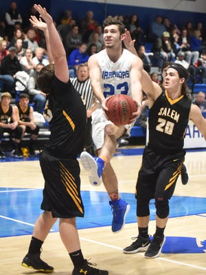 Cotter's Hunter Dearmore drives to the basket against Salem on Friday night at Cotter.