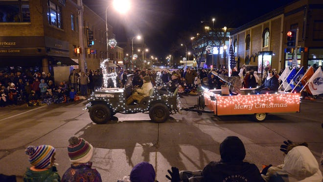 A Sioux Falls American Legion float drives down Phillips Ave Friday night during the annual Parade of Lights, Nov 23, 2012.  (Elisha Page / Argus Leader)
