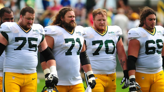 The Packers could be without their two starting guards, Josh Sitton (second from left) and T.J. Lang (third from left) on the offensive line Sunday against the Bears.