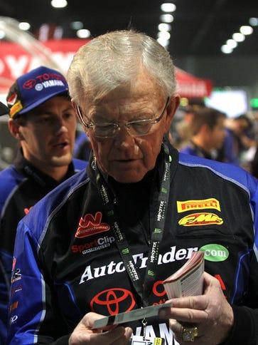Joe Gibbs, right, chats with NASCAR driver Carl Edwards