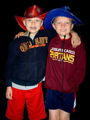 At left, Mario Orsini, 8, and Tyler Dax, 8