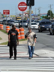 Pedestrians use a new crosswalk on Monday along the Coastal Highway north of Rehoboth Beach.