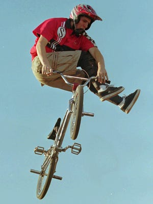 Joey Garcia, of Gilroy, Calif., performs a stunt during the X Games Bicycle Stunt Dirt Jumping preliminaries in Providence in June 1996.