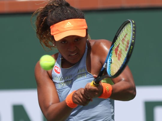 Naomi Osaka wins her match over Daria Kasatkina to win the BNP Paribas Open, March 18, 2018.