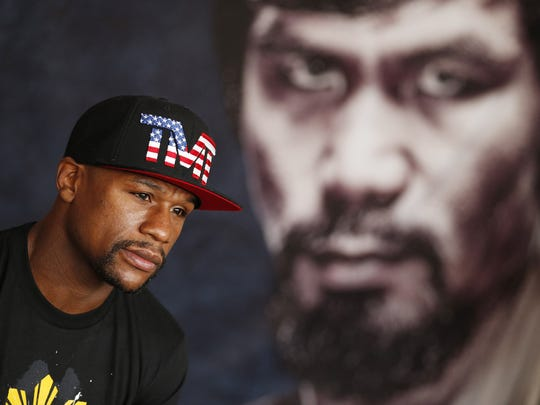 Floyd Mayweather Jr. speaks with the media before a workout on April 14 in Las Vegas. Mayweather is scheduled to fight Manny Pacquiao in a welterweight boxing match in Las Vegas on May 2.