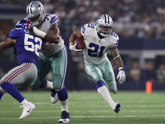 Sep 10, 2017; Arlington, TX, USA; Dallas Cowboys running back Ezekiel Elliott (21) runs with the ball off a block from guard Chaz Green (79) against New York Giants linebacker Jonathan Casillas (52) in the second quarter at AT&T Stadium.