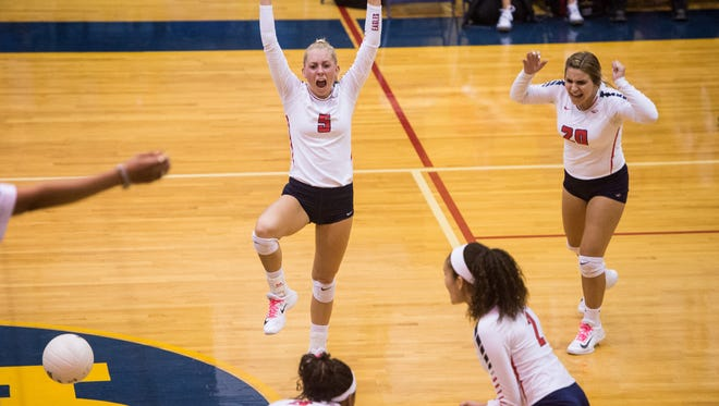 St. Lucie West Centennial's Tarrianne Henry (9) celebrates a winning point against Martin County in the District 8-9A semifinals Wednesday, Oct. 8, 2017, at Martin County High School in Stuart. The Eagles travel to Orlando on Tuesday for a Region 2-9A final against Olympia.