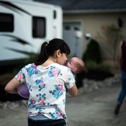 Paige O'Keefe, 14, holds her favorite doll Tuesday,