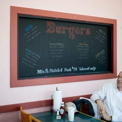 The menu board inside Bruni's Breakfast & Burgers new
