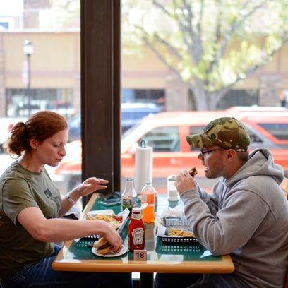 Annie Ponstingl, left, and Lewis Peacock eat burgers
