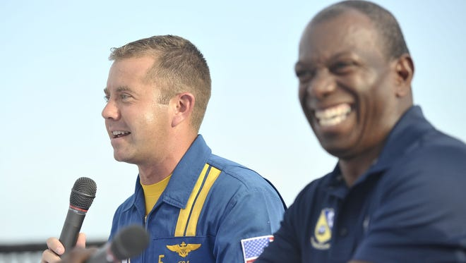 Former Pensacola Naval Air Station commanding officer and former lead solo, Keith Hoskins, right, and current Blue Angel #5 pilot Lt. Ryan Chamberlin answer audience questions.