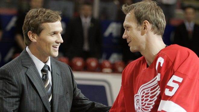 Retired Steve Yzerman, left, greets Nicklas Lidstrom, who replaced him as captain in 2006.