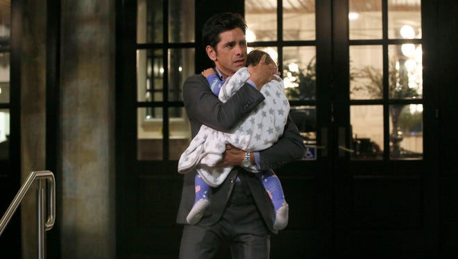 Jimmy (John Stamos) is having a not-so-happy moment in the series premiere of 'Grandfathered.'