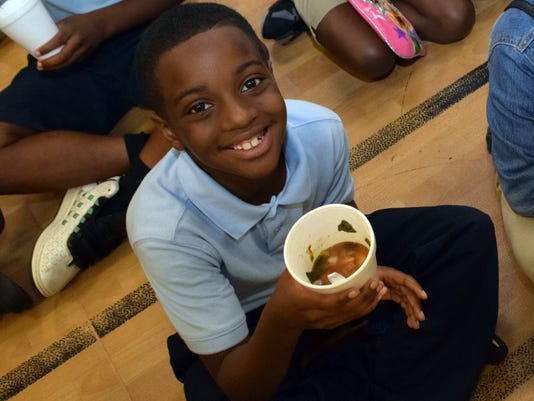 Jarvis Russell, a third-grader at Mabel Brasher Elementary School, likes the cabbage soup made from vegetables growing in the garden at Mabel Brasher Elementary School.