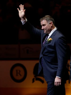 Former Philadelphia Flyers' Eric Lindros acknowledges the crowd during his induction ceremony into the Flyers Hall of Fame before an NHL hockey game against the Minnesota Wild in Nov. 2014. Lindros returned for the team's alumni game against Pittsburgh on Saturday.