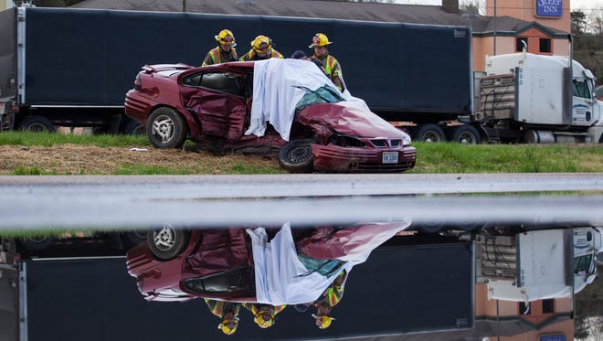 Augusta County Fire & Rescue personnel respond to the scene of a two-vehicle accident that left two people dead and two injured off of Jefferson Highway in Staunton on Monday, April 20, 2015.