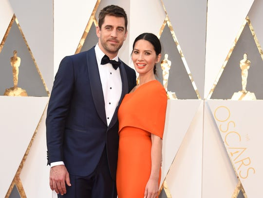 Aaron Rodgers and actress Olivia Munn attend the 88th
