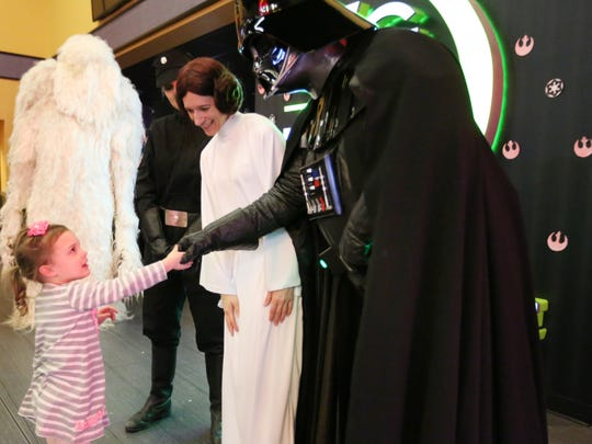 "Brynn Edler of Manitowoc meets Princess Leia and Darth Vader from ""Star Wars"" movies at Carmike Cinemas in Manitowoc Dec. 18, 2015."