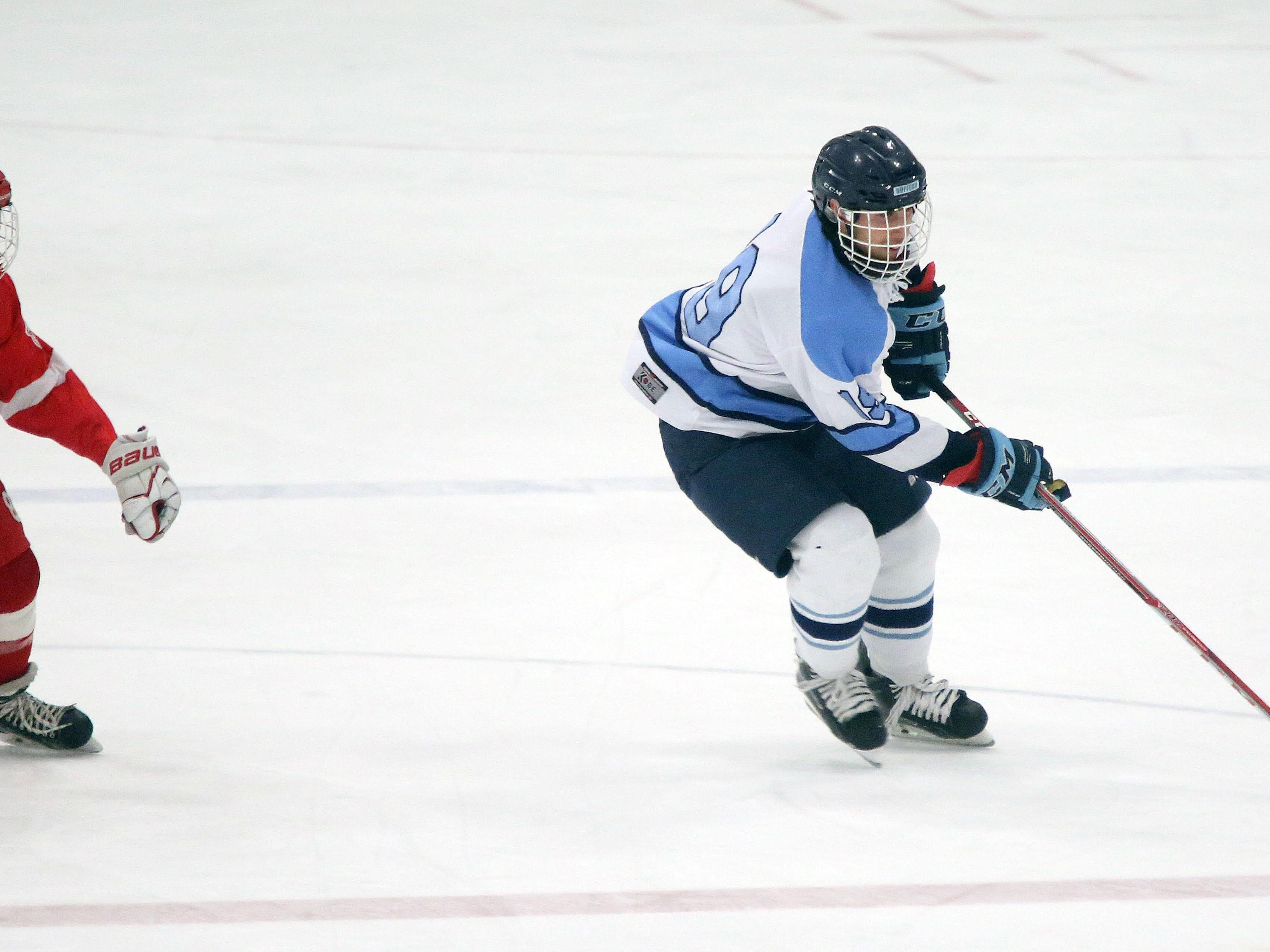 Suffern's Troy Daniels (19) pushes the puck past North Rockland's Justin Miklos (8) in the first period during the first period Section 1 Division 1 semifinal hockey at the Sport-O-Rama in Monsey at Feb. 26, 2016.