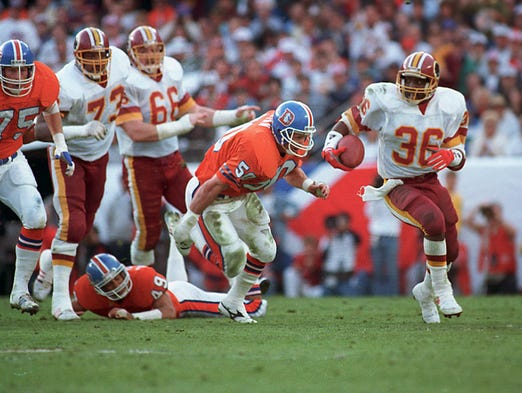 Super Bowl XXII (Redskins 42, Broncos 10): Washington Redskins running back Timmy Smith goes around Denver Broncos linebacker Jim Ryan on long run in the first quarter.
