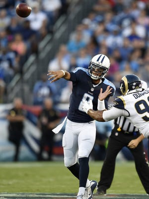 Titans coach Ken Whisenhunt would rather see Marcus Mariota working in the pocket for now and not scrambling.