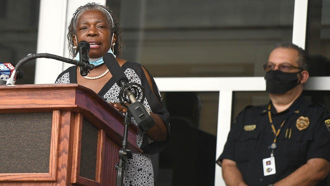 Canton Councilwoman Chris Smith speaks Friday on the steps of city hall. Canton officials called a press conference to address the three homicides that occurred over a single evening earlier in the week.