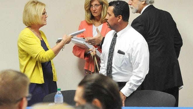 Tulare Regional Medical Center legal counsel Bruce Greene, right, collects lawsuits served to board members before the regular board meeting at Evolutions Fitness and Wellness Center on Wednesday.Tulare Regional Medical Center board of directors regular board meeting at Evolutions Fitness and Wellness Center on Wednesday, September 28, 2016.
