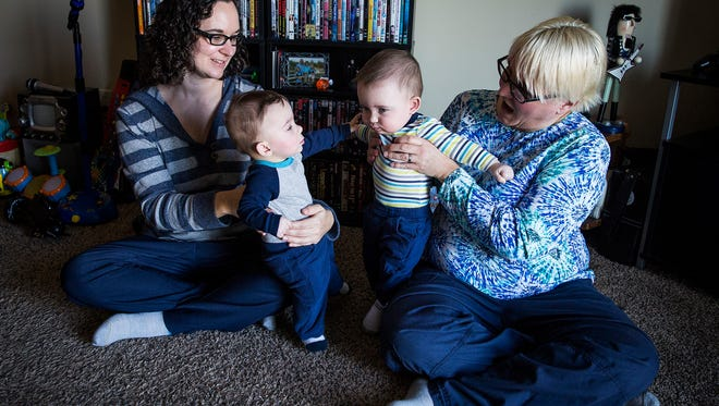 Cheri and Chanda Fouseridge sit with Cutter and Cincaid at their home in Farmland.