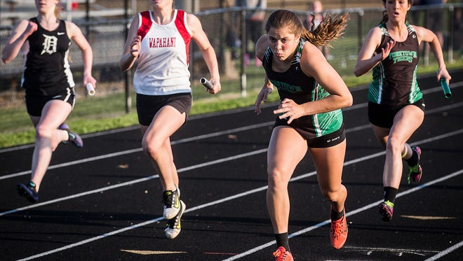 Yorktown pulls ahead in the 4x100 meter relay during the Delaware County Track and Field Championship at Delta High School Friday, May 6, 2016.