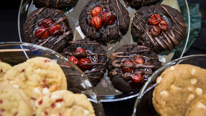 Featured desserts are positioned on a table at Minnetrista for bidders during the Just Desserts auction in a Star Press file photo.