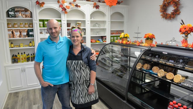 John and Jessi Brinkman, who own Mixin' It Up, the area's first gluten-free rental kitchen and retail store, pose inside the storefront Thursday, Sept. 22, on Second Avenue in Sauk Rapids.