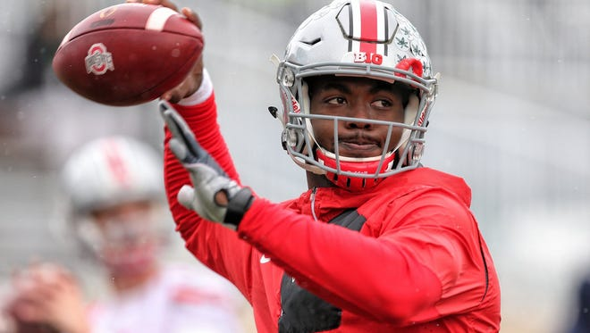 Ohio State Buckeyes quarterback J.T. Barrett (16) warms up prior to a game against the Michigan State Spartans at Spartan Stadium.