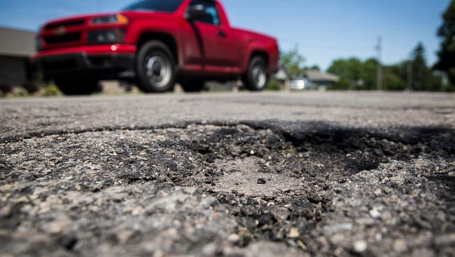 Large potholes mar Riverside Avenue near Ball State earlier this spring.