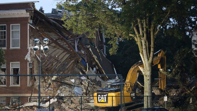 This photo shows the rubble Thursday, Aug. 3,  of a deadly explosion and partial building collapse at Minnehaha Academy the day before in Minneapolis.   City fire officials said Wednesday's collapse was caused by a natural gas explosion.