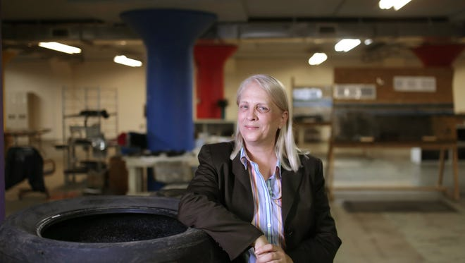 Rev. Faith Fowler poses for a photo in the Cass Green Industries building in Detroit on Tuesday, Aug. 16, 2016. She created the building to provide jobs for long-term unemployed people to take abandoned tires from illegal dumping areas in Detroit to turn into floor mats and sandals that sell for a reasonable profit. This also will be the site where portable solar panels will be built for hurricane relief in Puerto Rico.