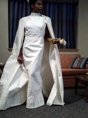 Turquoise Cobb models a toilet-paper wedding gown created by Susan Masarek Wilson of Collingswood.