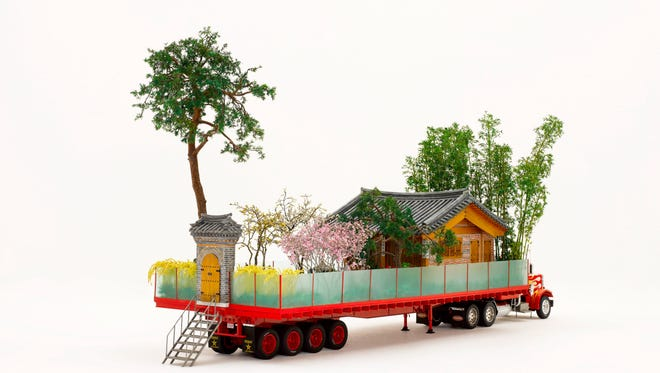 """Do Ho Suh's """"Secret Garden"""" is a 1/16th re-creation of his childhood home and garden, loaded onto the bed of an 18-wheeler."""